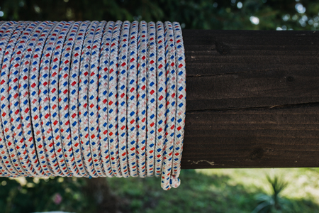 rope with dots tied around wood