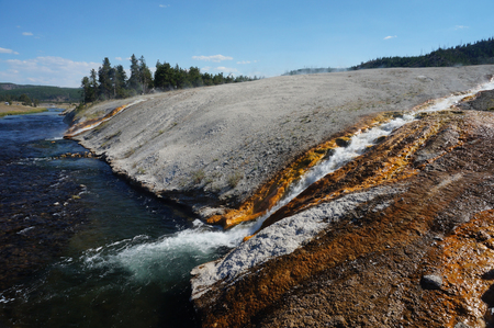 runoff: Midway Geyser Basin Hot Water Runoff into Firehole River Stock Photo