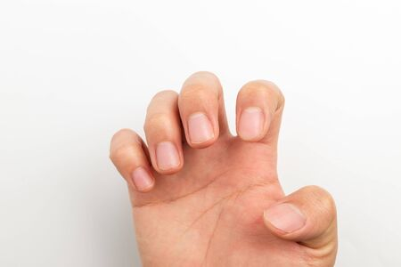 Fingers and nails. Adult man nails. Well-maintained nails