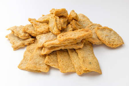 Food containing fish and flour. Fried food. Thin fry. Chewy food