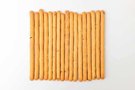 Snack with sesame flavor. Rod-shaped cookies. Dessert with a savory taste