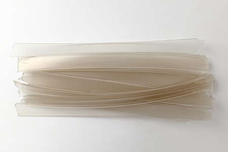 flat and thin food. noodles made from starch.