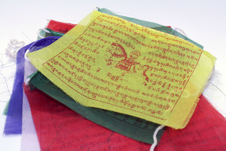 The colorful Tibetan Nepal Buddhism prayer flags. It has mantra on it.