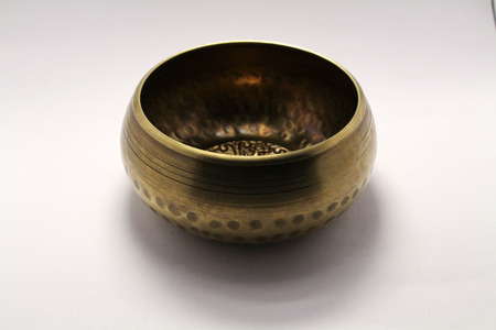 A Buddhist Tibetan singing bowl made in Nepal. A close up view.