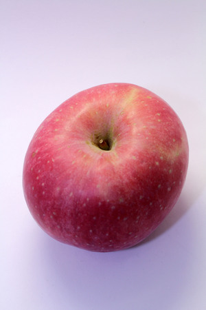 The red apple known as Apel Fuji (Fuji Apple). Bright pinky color.