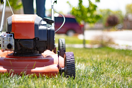 Lawnmower being used for lawn care Stock Photo