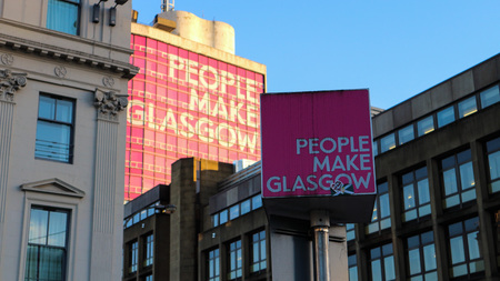 A pole on showing the slogan of the City of Glasgow Editorial