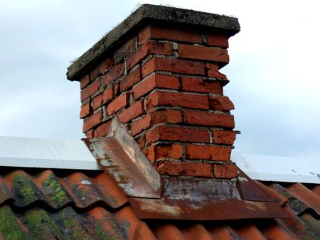 restauration: An old chimney in need of restauration with new bricks Stock Photo