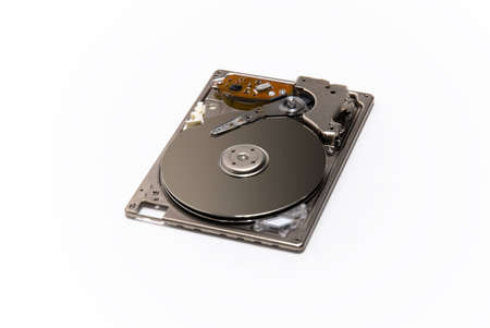 isolated hard drive disk on white background showing cylinders photo