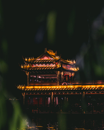 Temple with Warm Lights Framed with Leaves
