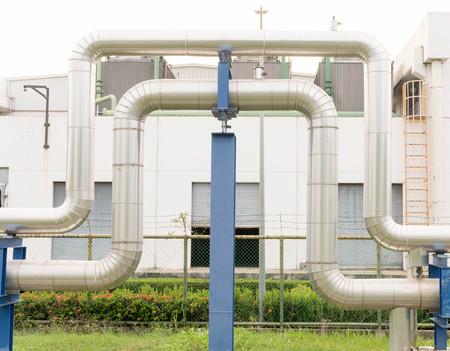 globalwarming: industrial pipelines on pipe-bridge Stock Photo