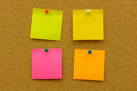 pin board: Colour note paper with colour pin on the cork board