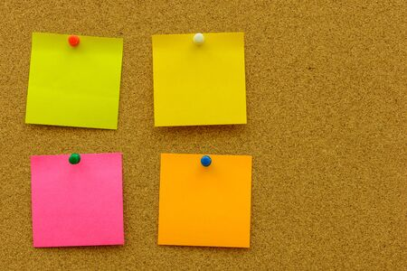 pin board: Color note paper with color pin on the cork board Stock Photo