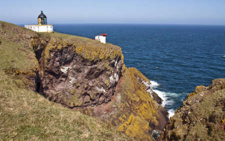 white lighthouse on a clifftop, st abbs head, Scotland Stock Photo