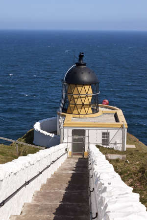Stairs to white lighthouse on a clifftop, st abbs head, Scotland Stock Photo