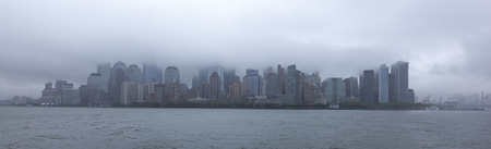 Lower Manhattan in clouds, New York City, USA photo