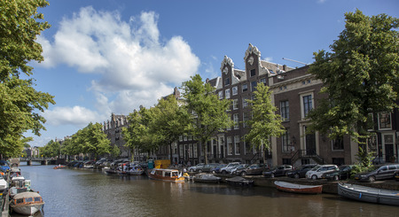 gabled house: Typical houses with spring sky, Amsterdam, the Netherlands Editorial