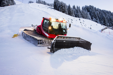 snow grooming machine: Piste Machine in action at skipiste Stock Photo
