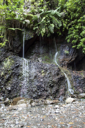 law of portugal: Beautiful waterfall and small lake in Levada 25 fountains Rabacal Madeira Portugal Stock Photo