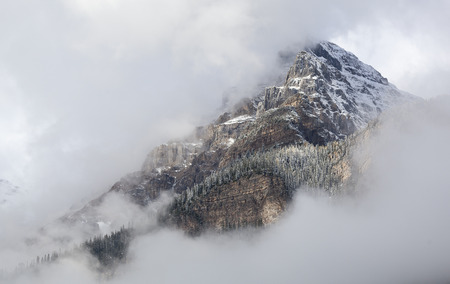 Mountain peak in white clouds