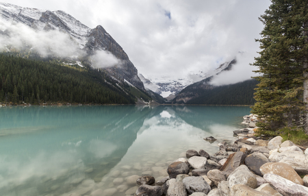 View on Lake Louise on a cloudy day Stock Photo
