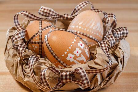 paper basket: Easter eggs in a paper basket