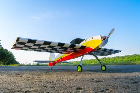 pilotage: training piloted model aircraft on blue sky background Stock Photo