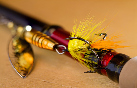 spinner: fly to tee spinner lures close-up on the handle spinning