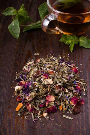 handful: a handful of herbal tea on a dark table