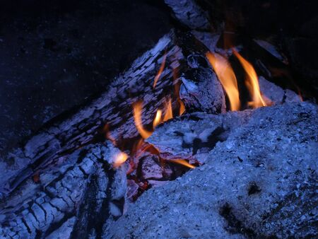 smoldering: the dying smoldering fire with a small flame Stock Photo