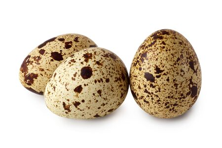 Three quail eggs isolated on a white background