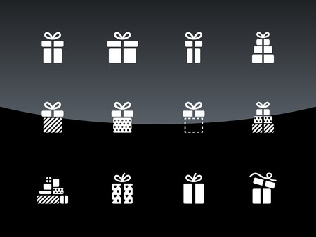 Christmas gift box icons on black background. Vector illustration.