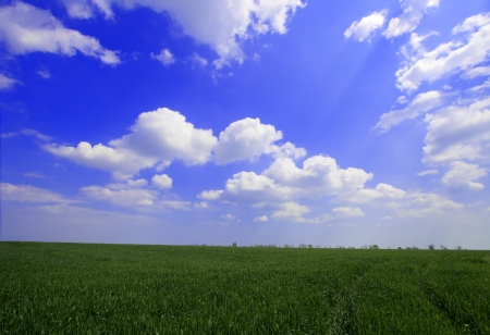 Beautiful farmlands with lovely clouds.  photo