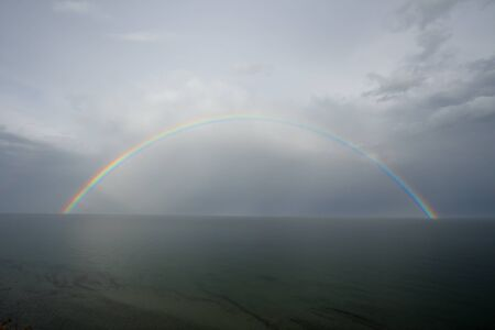 Rainbow on seacoast after a summer thunder-storm Stock Photo - 16017189