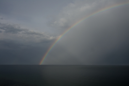 Rainbow on seacoast after a summer thunder-storm Stock Photo - 16017442