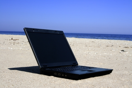 Laptop on seacoast photo