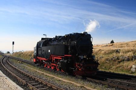 brocken: Old steam locomotive rising on mountain Brocken in Germany Stock Photo