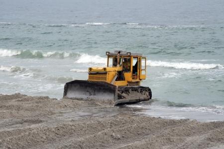 dragline: Dredge digging sand on seacost Stock Photo