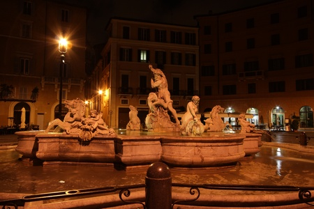 Fountain of the Neptune at night on area Navona in Rome Stock Photo