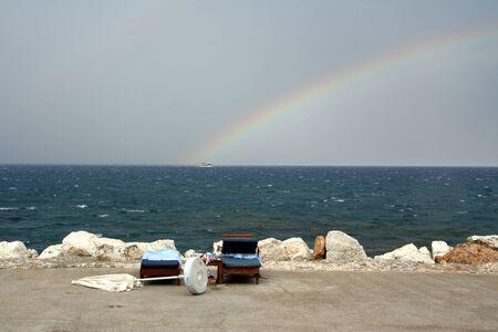 Rainbow on seacoast after a summer thunder-storm Stock Photo - 16096774