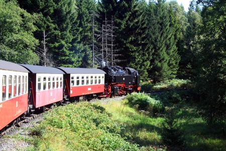 Old steam locomotive rising on mountain Brocken in Germany Standard-Bild