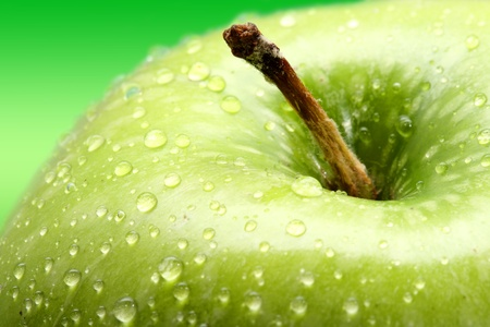 Green apple on a green background  photo