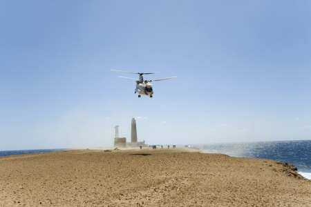 The cargo helicopter delivering products on island Stock Photo