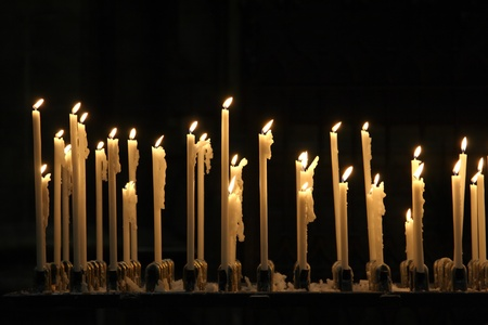 easter candle is burning: Burning candles in cathedral Duomo in Milan