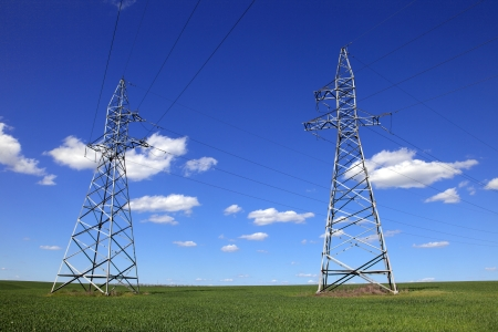 hight voltage line on the blue sky and green grass photo