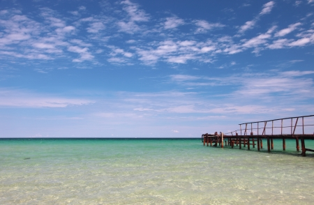 Old wooden pier on turquoise sea photo