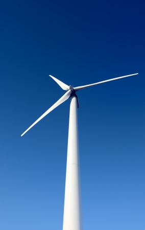 windpower generator on blue sky photo