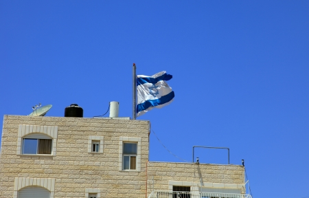 The Jewish flag fluttering on the house photo