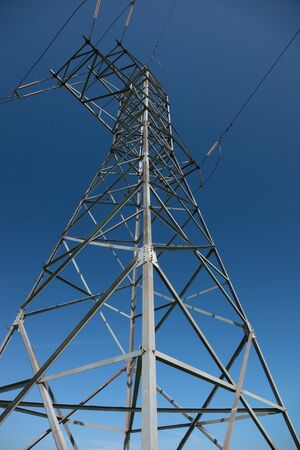 High-voltage tower against the blue sky photo
