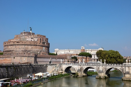 The famous bridge Ponte SantAngelo crossing the river Tiber and Castel SantAngelo in Rome, Italy